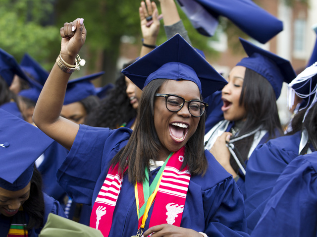 Ciearra Jefferson celebrates her graduation with her class after President Barack Obama delivered the Howard University's commencement speech during the 2016 Howard University graduation ceremony  ...