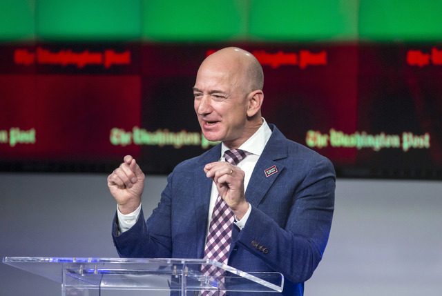 Billionaire Amazon founder and Washington Post owner Jeff Bezos talks about the history and character of the Post during a dedication ceremony for its new headquarters in Washington, Jan. 28, 2016 ...