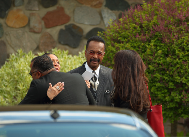 Larry Graham, center, arrive at a Jehovah's Witnesses Kingdom Hall for a memorial service for Prince, Sunday, May 15, 2016, in Minnetonka, Minn. (Jeff Wheeler/Star Tribune via AP)