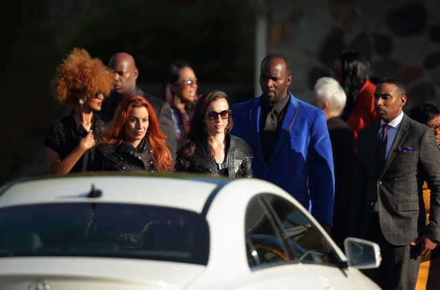 From left, Prince's personal assistant, Meron Bekure, 3rdEyeGirl bassist Ida Nielsen and guitarist Donna Grantis, former staffers Romeo and Mark Spark leave the Kingdom Hall following the memorial ...