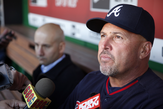 Atlanta Braves manager Fredi Gonzalez, right, with general manager John Coppolella sitting at left, talks with the media before a baseball game against the Washington Nationals at Nationals Park,  ...
