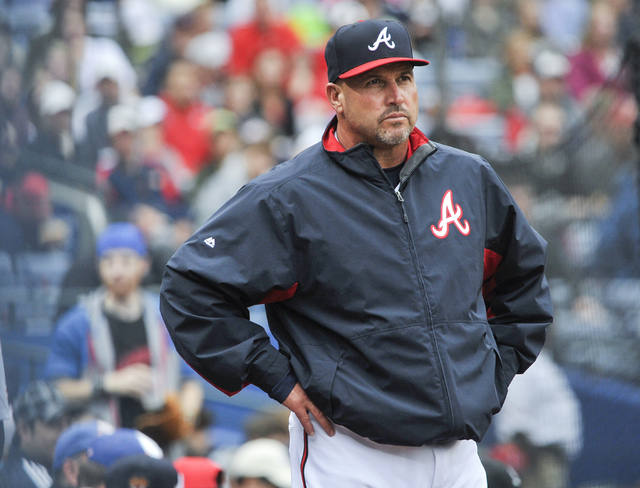 Atlanta Braves manager Fredi Gonzalez waits for a review of a call during the fourth inning of the second baseball game of a doubleheader against the St. Louis Cardinals, in Atlanta, Oct. 4, 2015. ...