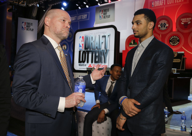Denver Nuggets head coach Michael Malone, left, talks with draft prospect Jamal Murray before the start of the NBA basketball draft lottery, Tuesday, May 17, 2016, in New York. (AP Photo/Julie Jac ...