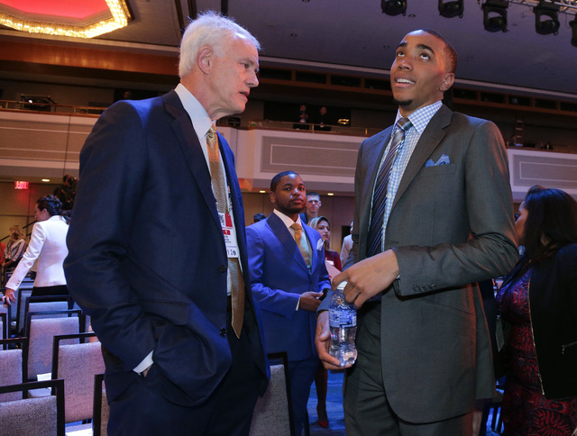 Los Angeles Lakers general manager Mitch Kupchak, left, talks with draft prospect Brice Johnson before the start of the NBA basketball draft lottery, Tuesday, May 17, 2016, in New York. (AP Photo/ ...