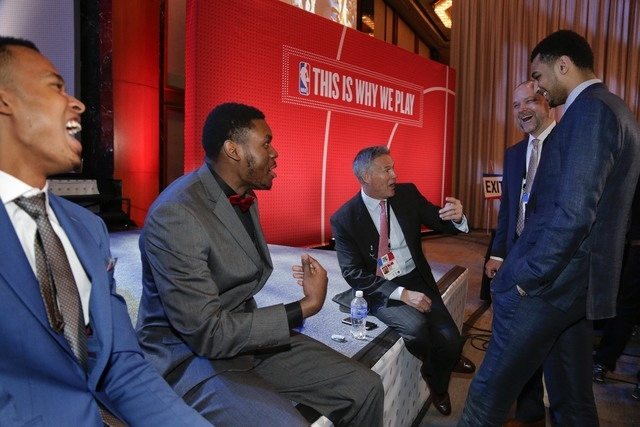Draft prospects Skal Labissiere, far left, Diamond Stone, second from left, and Jamal Murray, far right, talk with Denver Nuggets head coach Michael Malone, second from right, and Brett Brown, hea ...