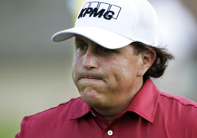Phil Mickelson reacts after making double bogey on the 17th hole during the first round of the Memorial golf tournament in Dublin, Ohio, May 29, 2014. (Jay LaPrete/AP)