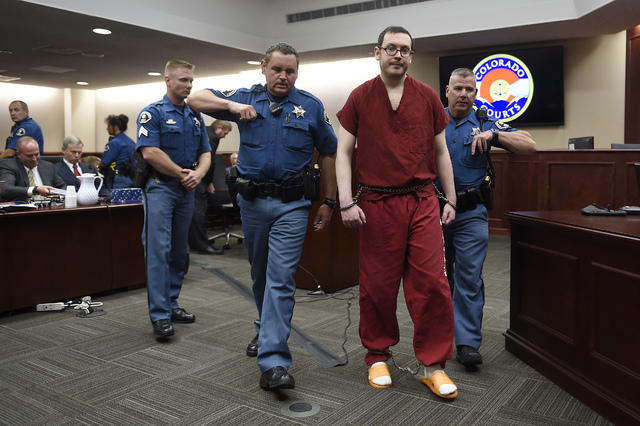 Colorado theater shooter James Holmes is led out of the courtroom after being formally sentenced in Centennial, Colo., Aug. 26, 2015. A jury decided Thursday, May 19, 2016 that the owner of the Co ...