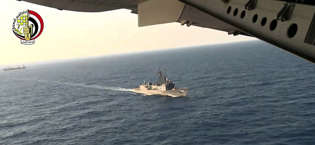 In this video image an Egyptian plane flies over an Egyptian ship during the search in the Mediterranean Sea for the missing EgyptAir flight 804 plane, which crashed after disappearing from the ra ...