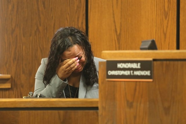 Witness and survivor Tiana Carruthers cries on the witness stand as Kalamazoo County Deputies remove defendant Jason Dalton after an outburst during his preliminary examination in district court o ...