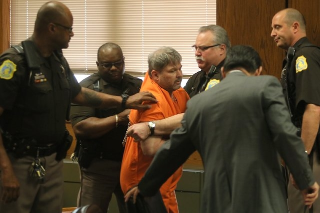 Kalamazoo County Deputies remove Jason Dalton after an outburst during his preliminary examination in district court on Friday, May 20, 2016 in Kalamazoo, Mich. Prosecutors say Dalton gunned down  ...