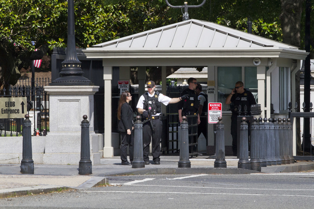 A Secret Service Police Officer works outside of the guard entrance on 17th Street Northwest near the White House in Washington, Friday, May 20, 2016, after the White House was placed on a securit ...