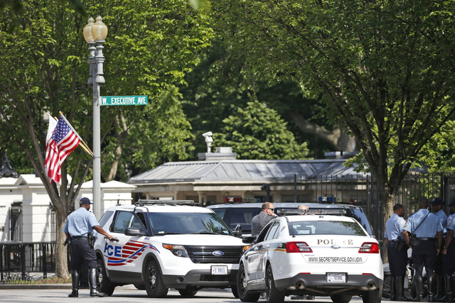 U.S. Secret Service officers are seen on Pennsylvania Avenue near the White House in Washington, Friday, May 20, 2016, after the White House was placed on a security alert after a shooting on a st ...