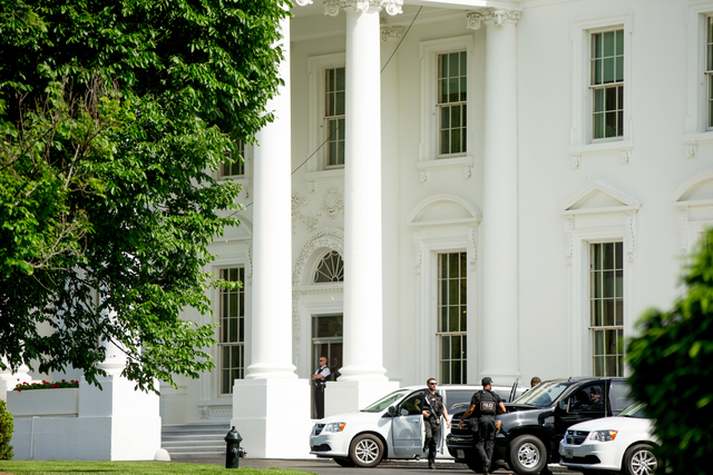 Secret Service agents stand near the North Lawn of the White House in Washington, Friday, May 20, 2016, after the White House is placed on lockdown for a shooting nearby. (Andrew Harnik/AP)