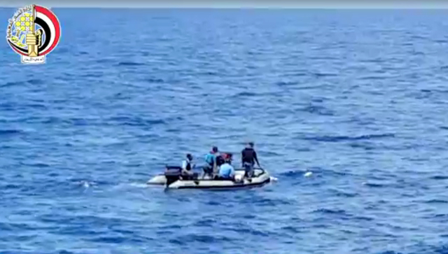 This still image taken from video posted Saturday, May 21, 2016, on the official Facebook page of the Egyptian Armed Forces spokesman shows an Egyptian dinghy collecting wreckage of EgyptAir fligh ...