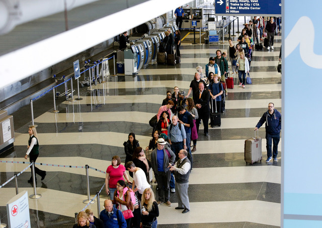 In this May 16, 2016 file photo, a long line of travelers waiting for the TSA security check point at O'Hare International airport in Chicago. (AP Photo/Teresa Crawford, File)