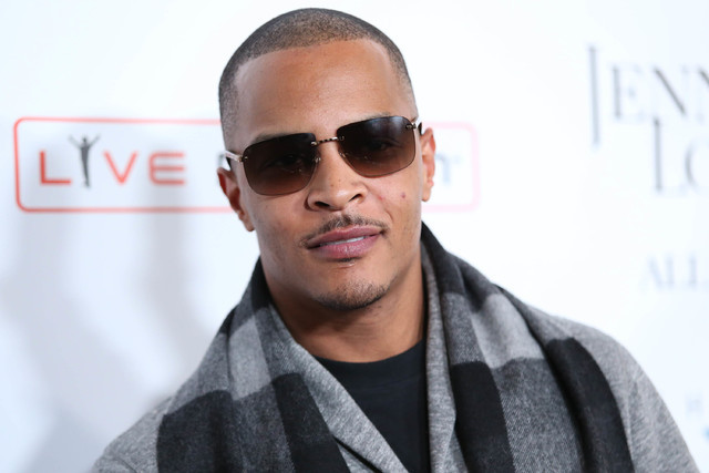 "FILE- In this Jan. 20, 2016, file photo, T.I. arrives at the grand opening of ""Jennifer Lopez: All I Have"" show at Planet Hollywood Resort & Casino in Las Vegas. According to ..."