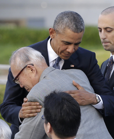 U.S. President Barack Obama hugs Shigeaki Mori, an atomic bomb survivor; creator of the memorial for American WWII POWs killed at Hiroshima, during a ceremony at Hiroshima Peace Memorial Park in H ...