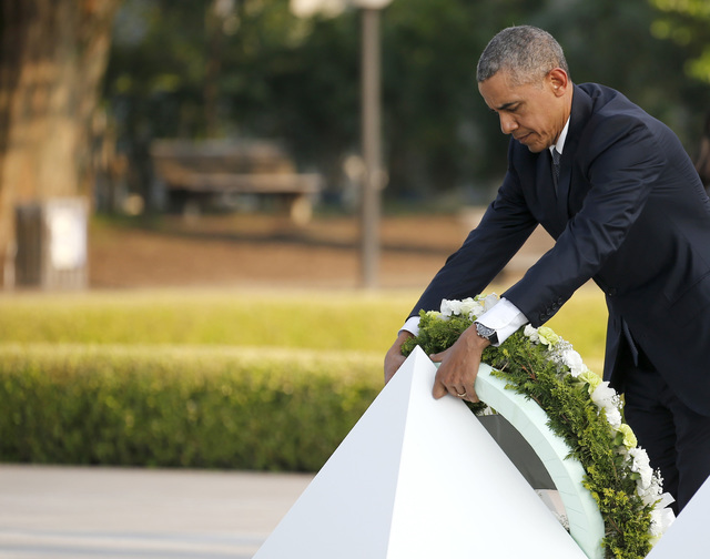 U.S. President Barack Obama lays a wreath at Hiroshima Peace Memorial Park in Hiroshima, western, Japan, Friday, May 27, 2016. Obama on Friday became the first sitting U.S. president to visit the  ...