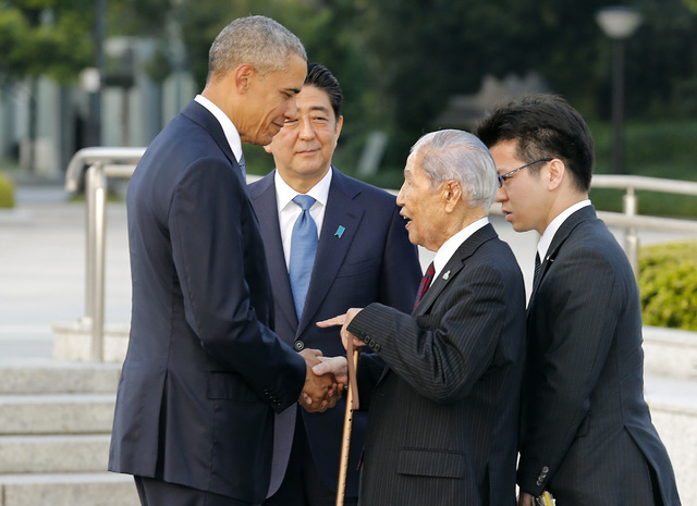 U.S. President Barack Obama, left, shakes hands and chats with Sunao Tsuboi, second right, a survivor of the 1945 atomic bombing and chairman of the Hiroshima Prefectural Confederation of A-bomb S ...
