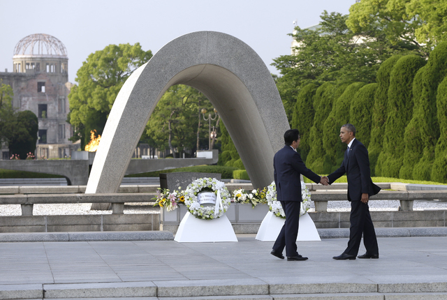 U.S. President Barack Obam, right, and Japanese Prime Minister Shinzo Abe shake hands after laying wreaths at Hiroshima Peace Memorial Park in Hiroshima, western, Japan, Friday, May 27, 2016. Obam ...