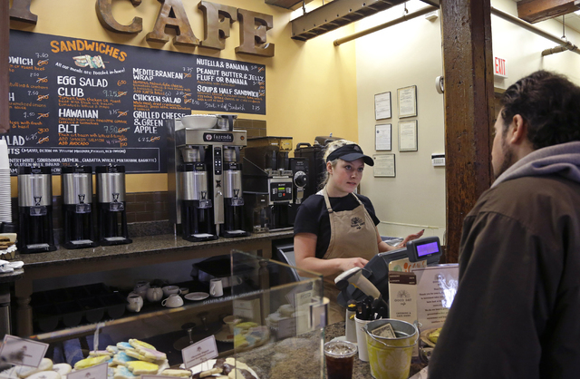 In this Wednesday, March 23, 2016, photo, Kayla Mitchell serves a customer at Good Day Cafe in North Andover, Mass. On Friday, May 27, 2016, the Commerce Department issues the second of three esti ...