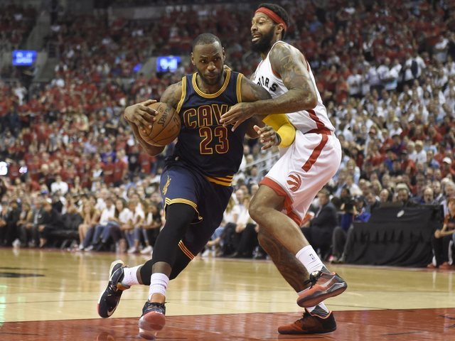 Cleveland Cavaliers forward LeBron James drives to the basket as Toronto Raptors forward James Johnson defends during the second half of Game 6 of the NBA basketball Eastern Conference finals, Fri ...