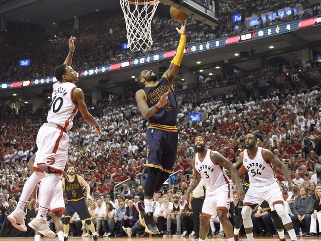 Cleveland Cavaliers guard Kyrie Irving releases a lay-up as Toronto Raptors guard DeMar DeRozan (10) defends during the second half of Game 6 of the NBA basketball Eastern Conference finals, Frida ...