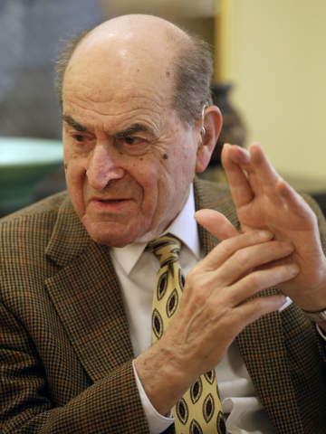 FILE - In this Feb. 5, 2014 file photo, Dr. Henry Heimlich describes the maneuver he developed to help clear obstructions from the windpipes of choking victims, while being interviewed at his home ...