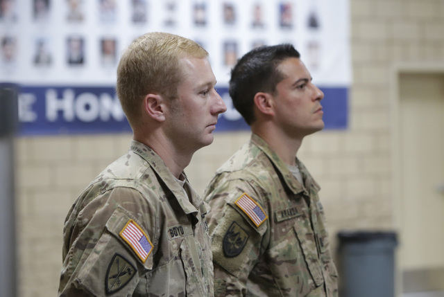 Staff Sgt. Sam Boyd, grandson of casino magnate Bill Boyd, left, and Capt. Lorenzo Aranda, stand at attention during a homecoming ceremony for the Nevada Army National Guard's 72nd Military Police ...