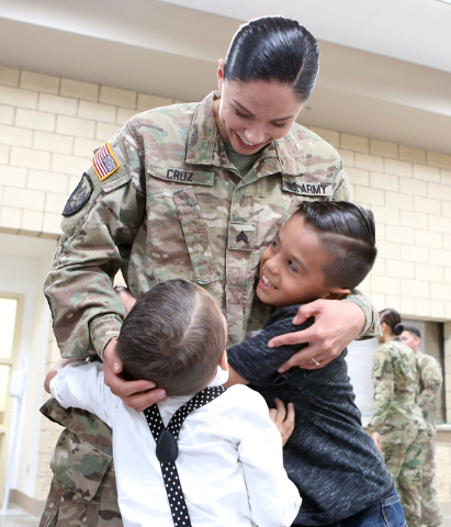 Sgt. Chelsea Cruz hugs her sons Leo, left, 4, and Robby, 8, after a homecoming ceremony for the Nevada Army National Guard's 72nd Military Police Company at North Las Vegas Readiness Center Friday ...