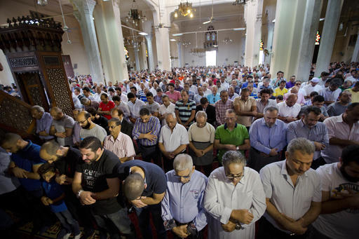 Egyptians perform prayers for the dead for victims of EgyptAir flight 804 at al Thawrah Mosque in Cairo, Egypt, Friday, May 20, 2016. The Airbus A320 plane was flying from Paris to Cairo with 66 p ...