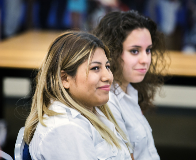 Yessenia Hicks, left, and Lin Martinez, students in the 911 Program at Veterans Tribute Career and Technical Academy, attend a press conference on Tuesday, May 10, 2016. The students helped produc ...
