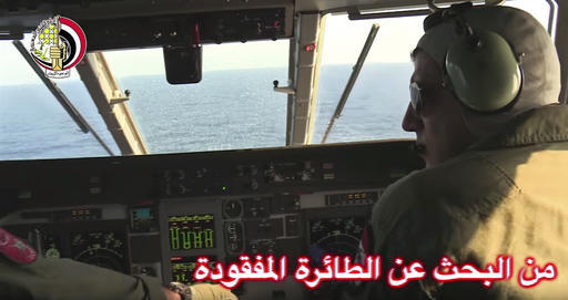In this Thursday, May 19, 2016 video image released by the Egyptian Defense Ministry, an Egyptian plane searches in the Mediterranean Sea for the missing EgyptAir flight 804 plane which crashed af ...