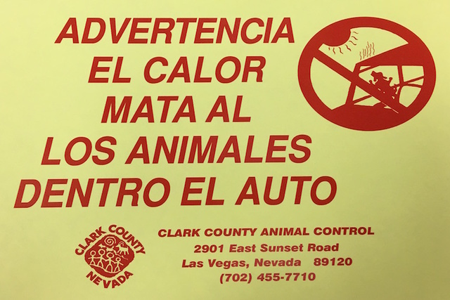 When officers remove a pet from a vehicle, they plaster the vehicle with these warning signs, in English and Spanish. (Caitlin Lilly/Las Vegas Review-Journal)