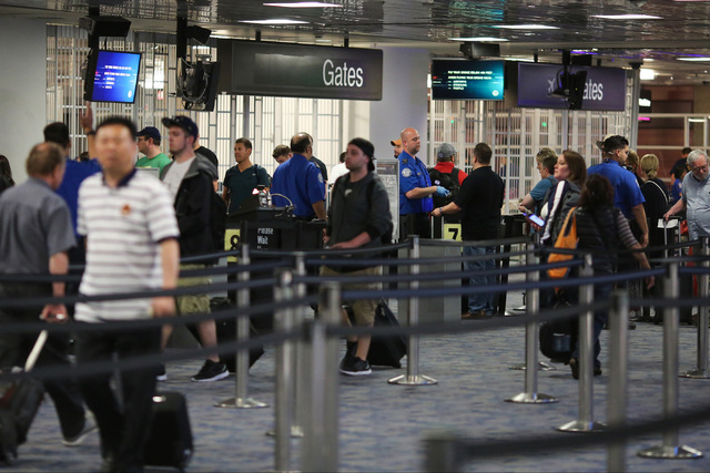 Passengers wait in a Transportation Security Administration screening line at Terminal 1 of McCarran International Airport in Las Vegas on Friday, May 20, 2016. Brett Le Blanc/Las Vegas Review-Jou ...