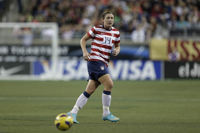 United State's Abby Wambach (14) passes in the first half of a international friendly soccer match against China at Ford Field in Detroit, Saturday, Dec. 8, 2012. (Paul Sancya/AP)