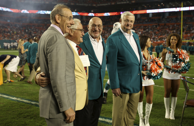 Miami Dolphins owner Stephen Ross, left, poses with former Dolphins coach Don Shula, second from left, former Dolphins safety Jake Scott, third from left, and former Dolphins defensive end Bill St ...