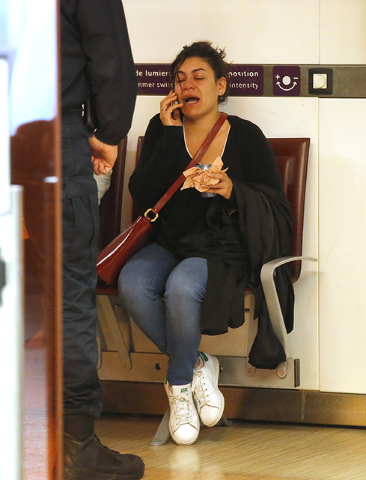 A relative of the victims of the EgyptAir flight 804 reacts as she makes a phone call at Charles de Gaulle Airport outside of Paris, Thursday, May 19, 2016. Egyptian aviation officials say an Egyp ...