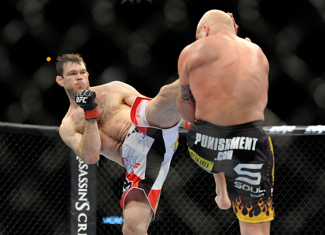 Forrest Griffin, shown against Tito Ortiz in 2012, now works as a performance consultant for the UFC and helps fighters understand the right way to cut weight, something he said he didn't know d ...