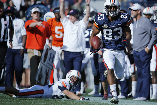 Auburn wide receiver Ryan Davis runs in for a touchdown that was called back in the second half of a spring NCAA college football game Saturday, April 9, 2016, in Auburn, Ala. (Brynn Anderson/AP)