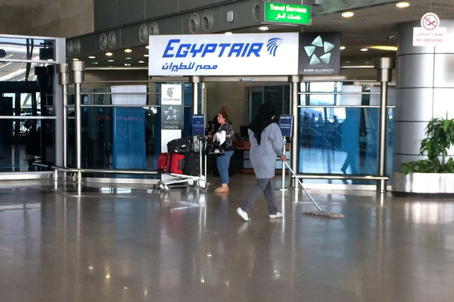 The Egyptair logo is seen at the arrivals section of Cairo International Airport, Egypt, Thursday, May 19, 2016. An EgyptAir flight from Paris to Cairo carrying 66 people disappeared from radar ea ...