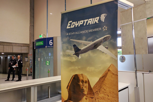 Airport security staff stand near the EgyptAir counter at Charles de Gaulle Airport outside of Paris, France, Thursday, May 19, 2016. EgyptAir said a flight from Paris to Cairo disappeared from ra ...