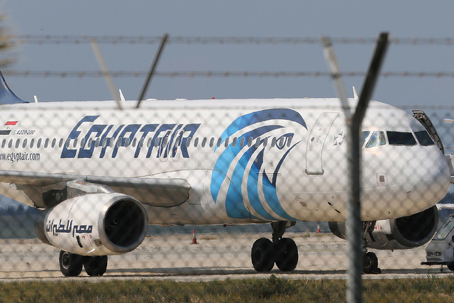 In this Tuesday, March 29, 2016, file photo, the hijacked aircraft of Egyptair after landing at Larnaca airport, Cyprus.  A similar Airbus A320 EgyptAir plane from Paris to Cairo carrying 66 peopl ...