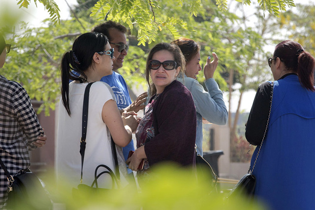 Relatives of passengers on a vanished EgyptAir flight grieve as they leave the in-flight service building where they were held at Cairo International Airport, Egypt, Thursday, May 19, 2016. (AP Ph ...