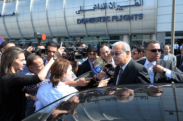 Egyptian Prime Minister Sherif Ismail talks to reporters at Cairo International Airport, Thursday, May 19, 2016. He said it was too early to say whether a technical problem or a terror attack caus ...