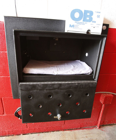 The Safe Haven Baby Box at the Woodburn, Ind., Volunteer Fire Department, is temperature-controlled and sounds an alarm when the door is opened. The baby box allows mothers to drop off unwanted ne ...