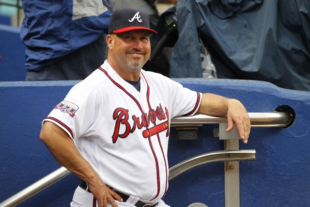 Atlanta Braves manager Fredi Gonzalez smiles in the dugout prior to a baseball game against the Philadelphia Phillies, Thursday, May 12, 2016, in Atlanta. (AP Photo/Brett Davis)