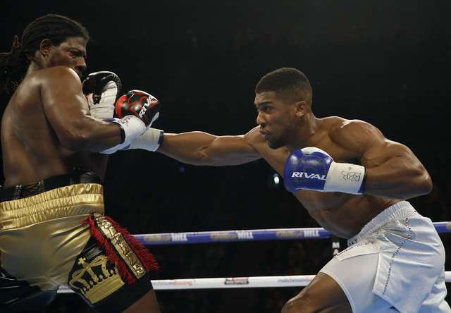 US boxer Charles Martin fights British boxer Anthony Joshua, right, during their IBF heavyweight title bout at the O2 Arena in London, Saturday, April 9, 2016.(Matt Dunham/AP)