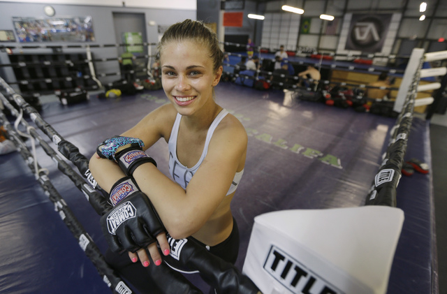 Paige VanZant poses after her workout at the Ultimate Fitness gym in Sacramento, Calif., in 2015. (Rich Pedroncelli/The Associated Press)
