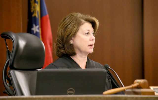Cobb County Superior Court Judge Mary Staley delivers her findings in the pretrial motion hearing Tuesday, Sept. 15, 2015, in the Justin Ross Harris murder case, in Marietta, Ga.  (Kelly J. Huff/M ...